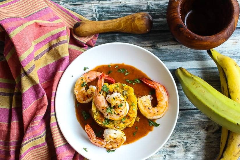mofongo relleno topped with shrimp and red pepper sauce #shrimp #mofongo www.foodfidelity.com