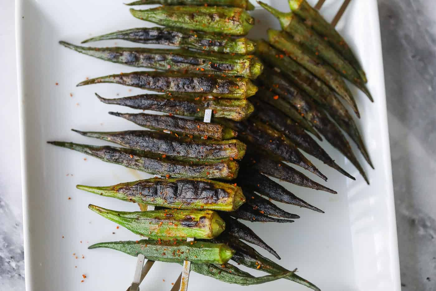 grilled okra on a white plate
