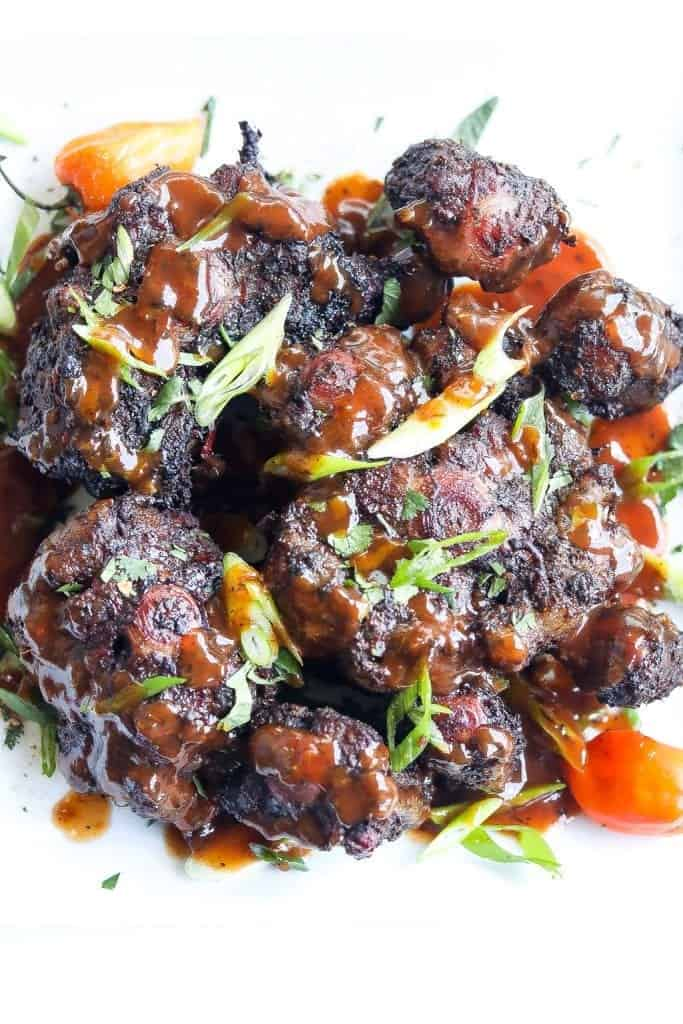 jerk smoked oxtails topped with jerk bbq sauce