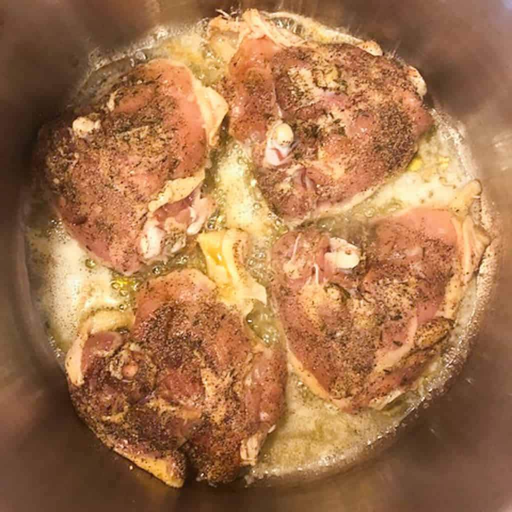 chicken browning in pan