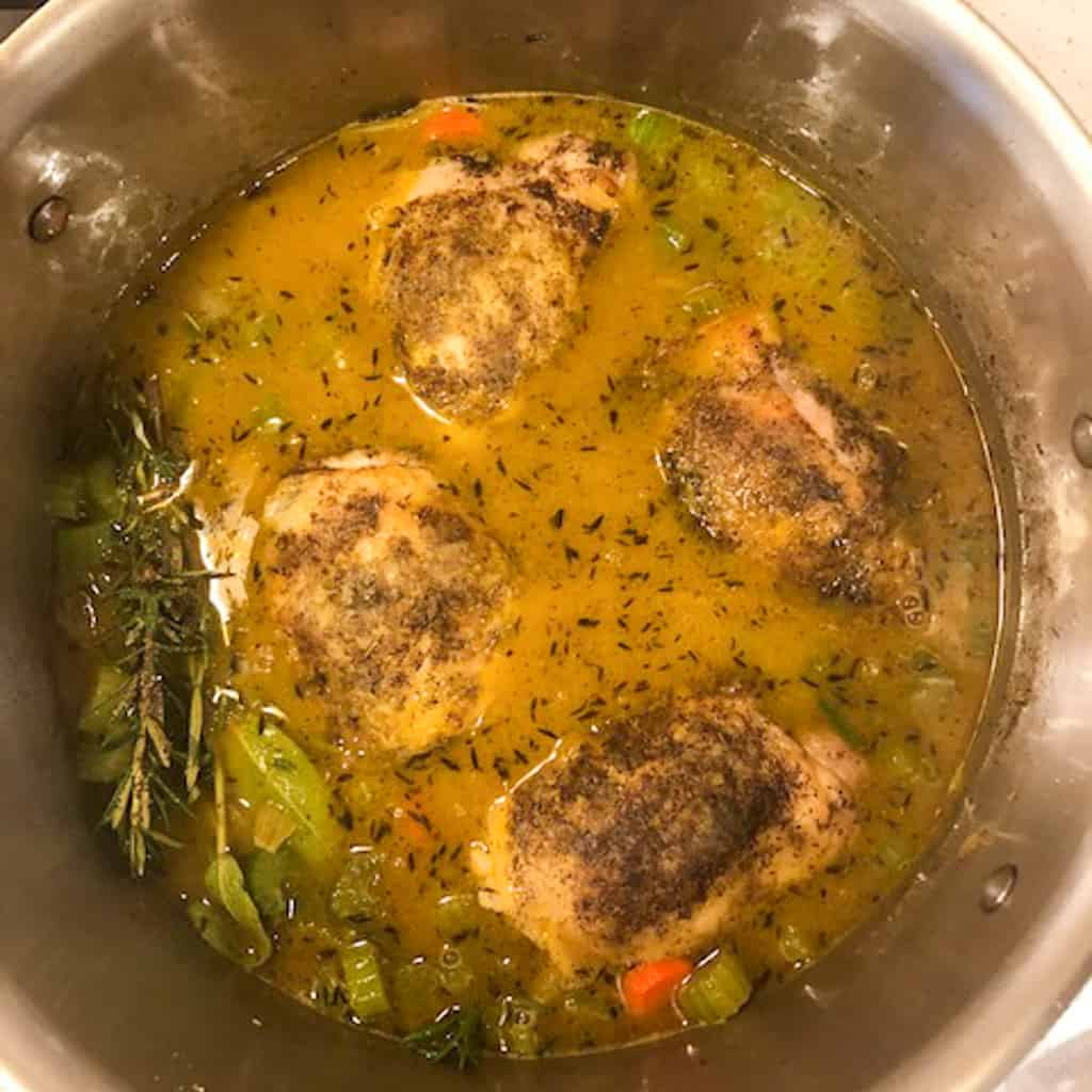 chicken soup cooking in pot