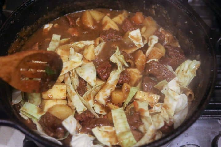 haitian soup stewing in pot