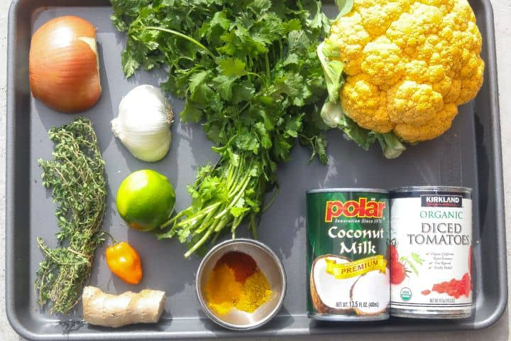 cauliflower curry recipe ingredients on a tray