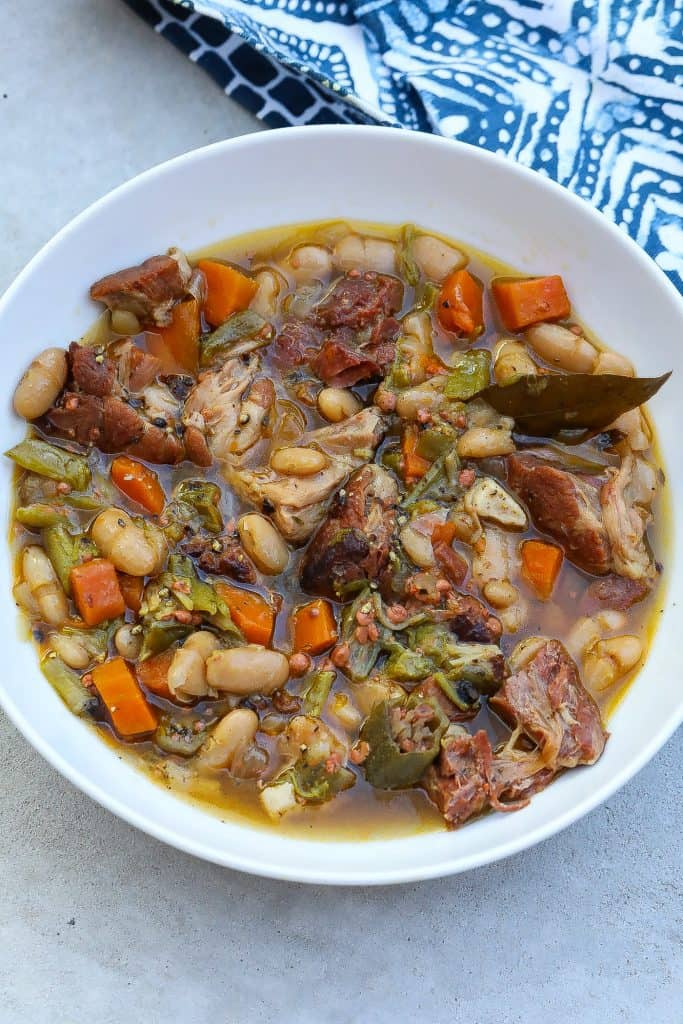 white bean stew with ham hocks in a bow