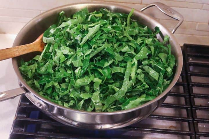 collard greens cooking in a pan