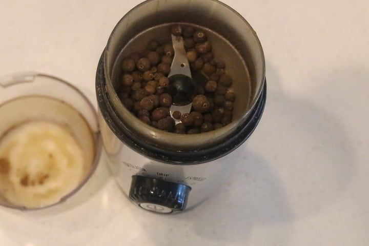 pimento berries in coffee grinder