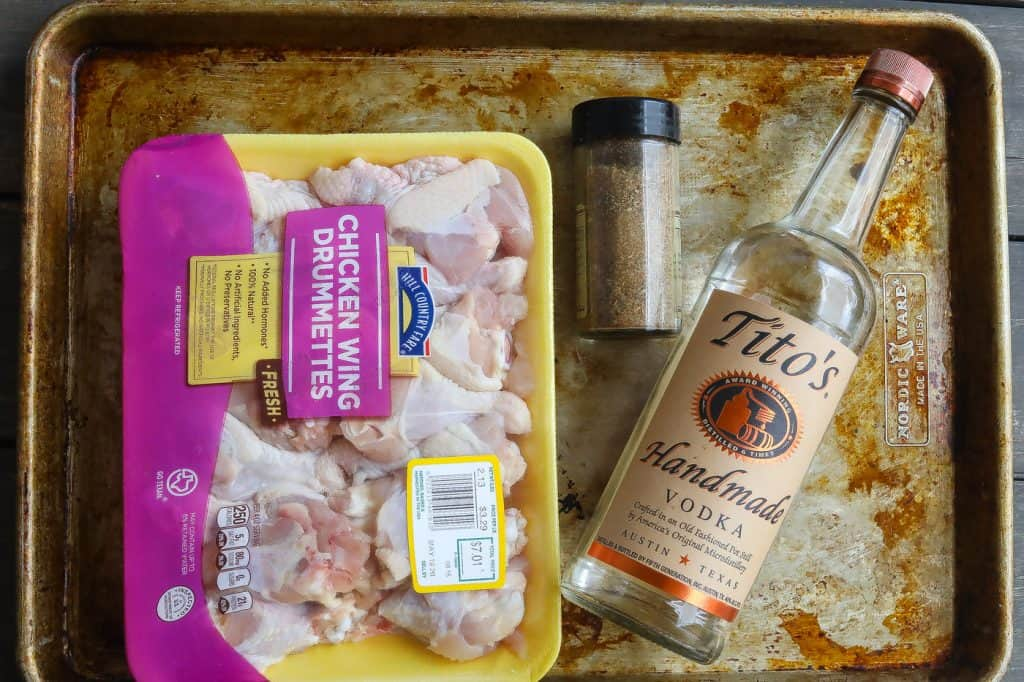 wings, spices, and vodka on a tray