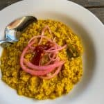 oatmeal curry topped with pickled red onions