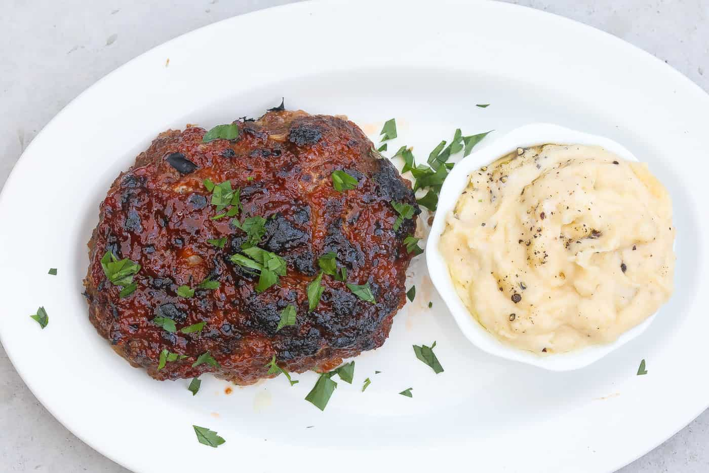 meat loaf and mashed potatoes on a white plate