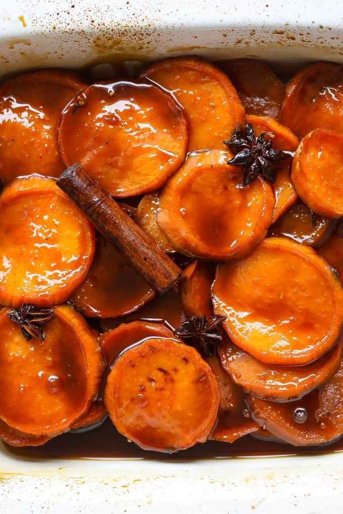 candied yams in a white baking dish