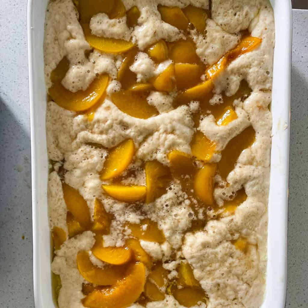 peach cobbler mix in whit pan