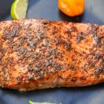jerk salmon on a black plate