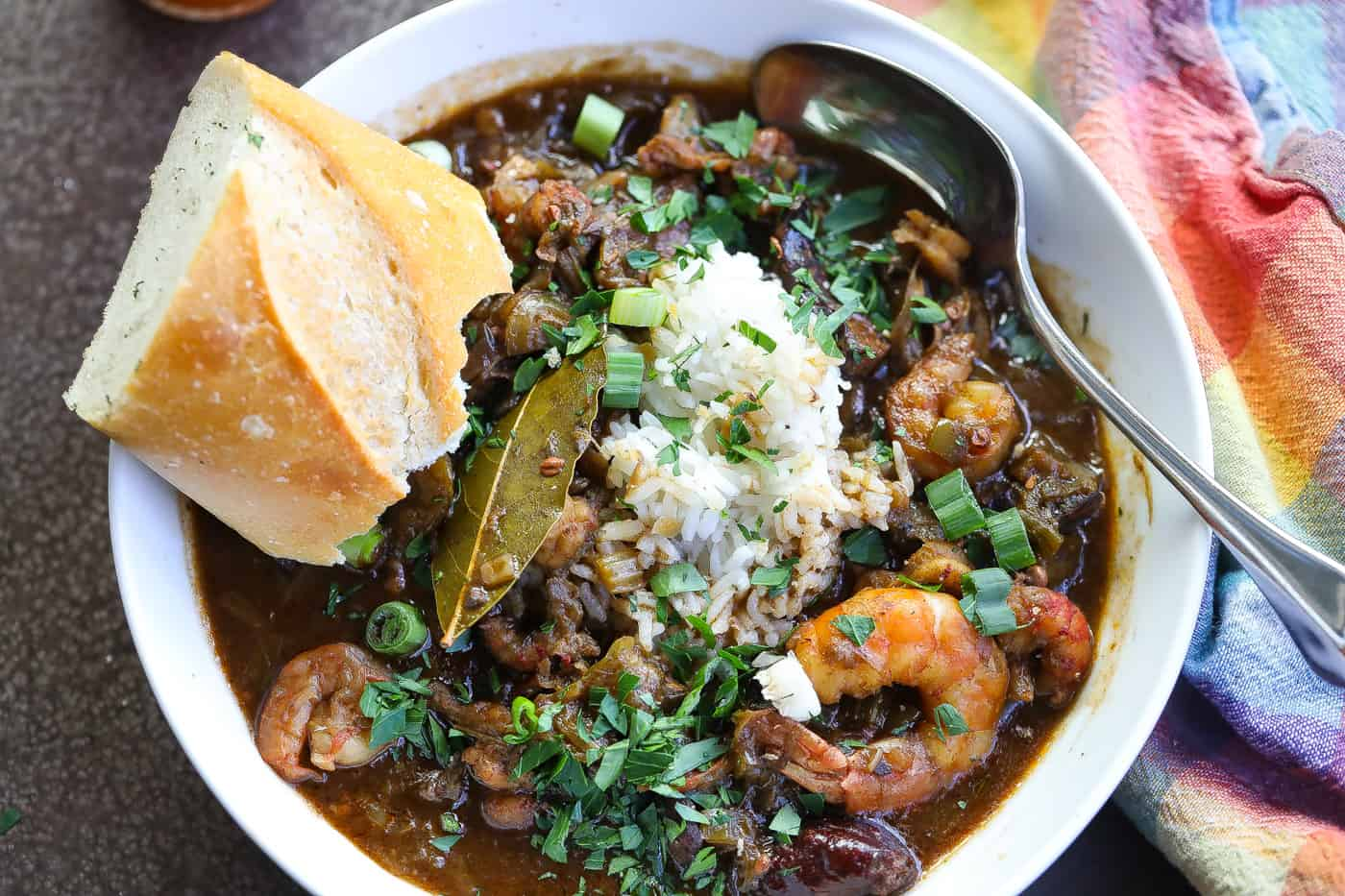gumbo with rice and seafood in a white bowl