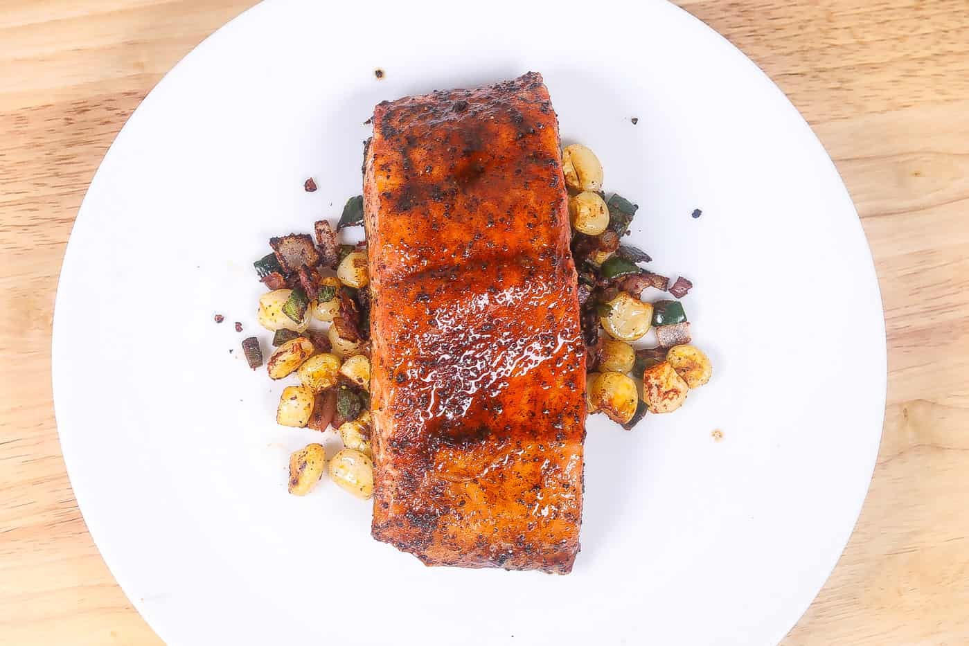 broiled salmon with corn on a white plate