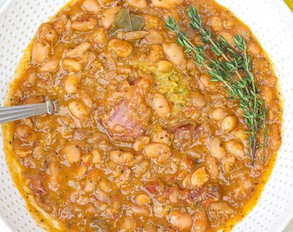 pinto beans with ham hocks in white bowl