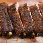 baked ribs on cutting board