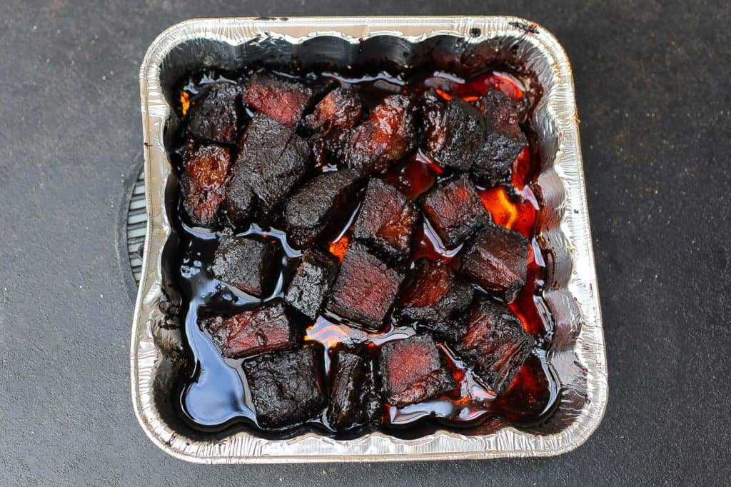 beef burnt ends in an aluminum pan