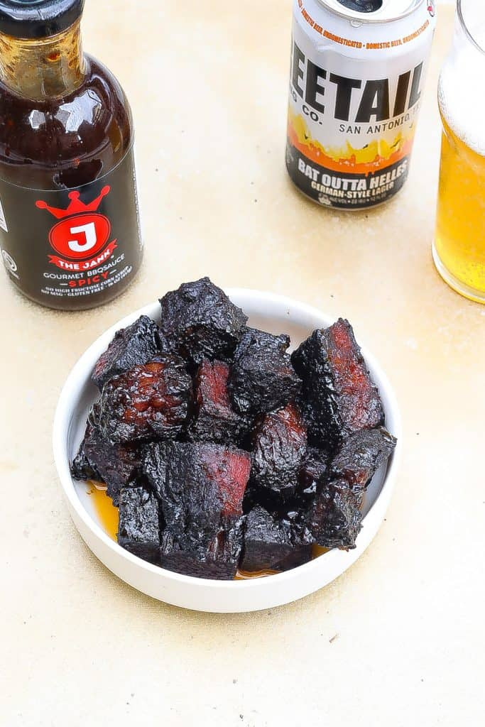 beef burnt ends in a white bowl