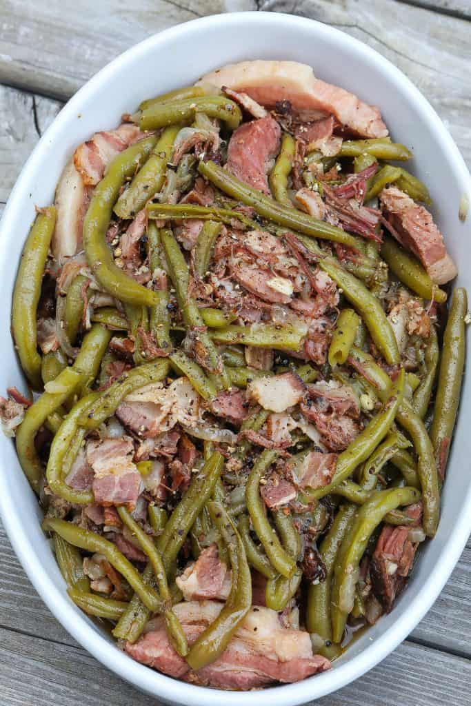 green beans and bacon in white oval bowl